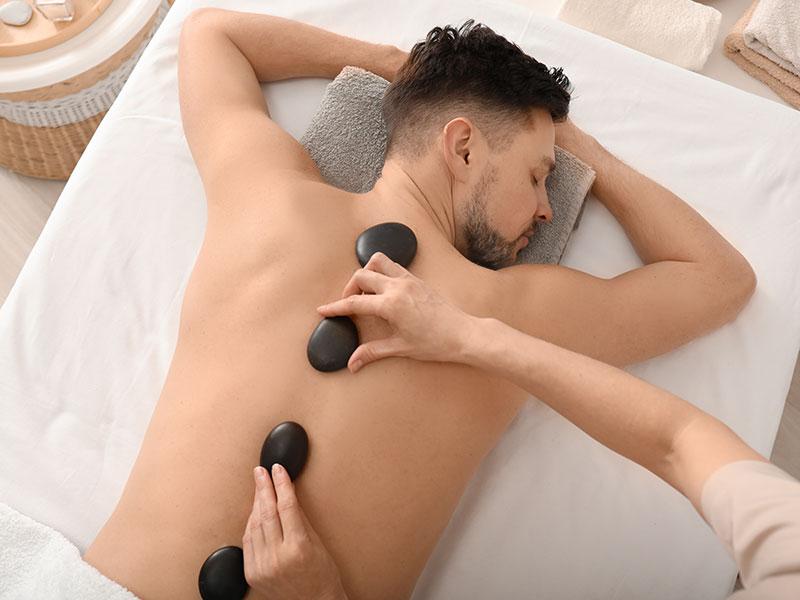 Man Receiving Hot Stone Massage